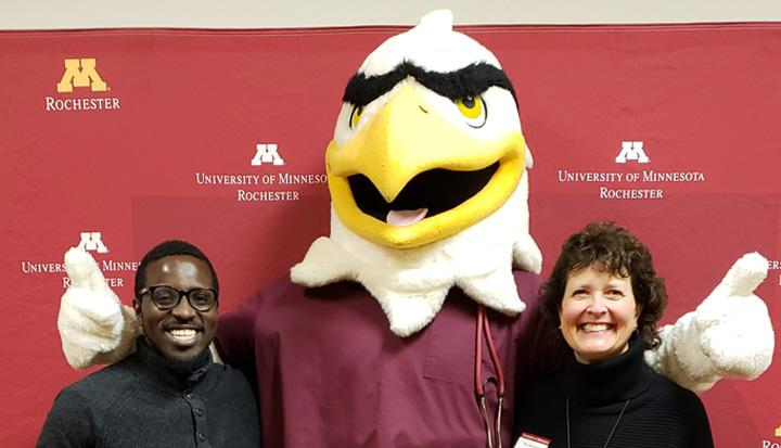 Regents Davenport and Kenyanya with Rockie Raptor during a visit to the Rochester campus.